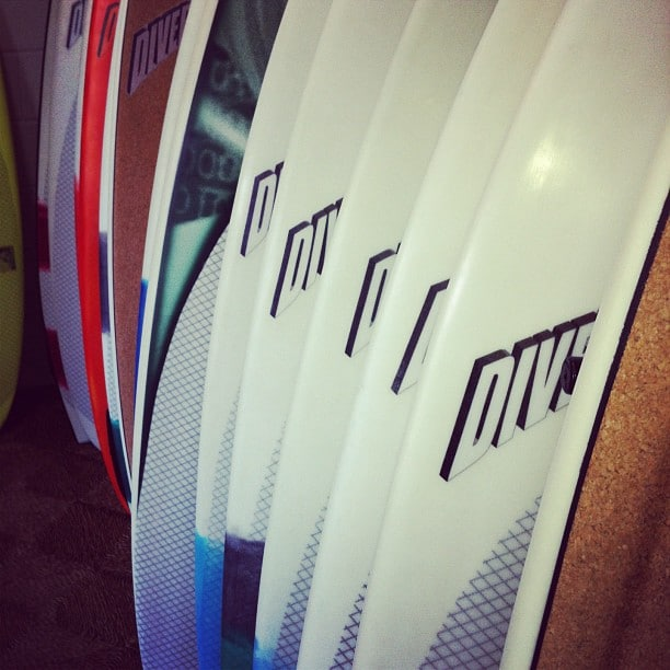 Row of #customs #surfshapes #dynocore in a #surfshop